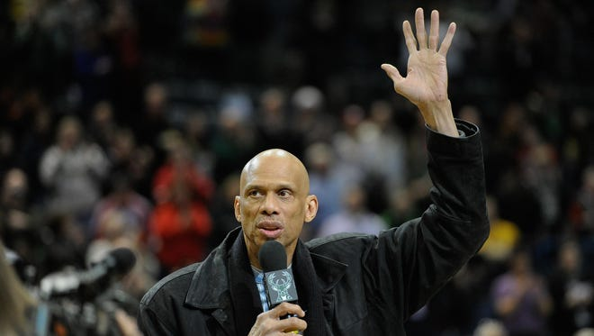 All-time leading scorer Kareem Abdul-Jabbar addresses the Milwaukee crowd at the Bucks game Monday night.