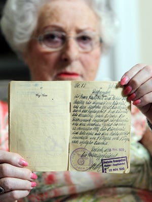 Stephanie Marks, 90, a native of Poland and Holocaust survivor, holds her Belgian passport..  The Enquirer/Patrick Reddy