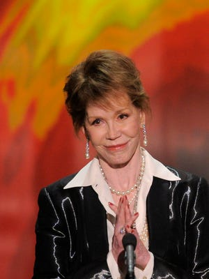 Mary Tyler Moore accepts the Life Achievement award at the 18th Annual Screen Actors Guild Awards on Sunday Jan. 29, 2012 in Los Angeles. (AP Photo/Mark J. Terrill)