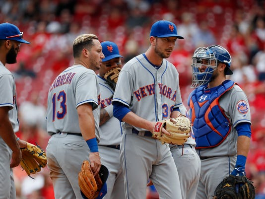New York Mets relief pitcher Jerry Blevins (39) is relieved in the eighth inning of a baseball game against the Cincinnati Reds, Thursday, Aug. 31, 2017, in Cincinnati. The Reds won 7-2. (AP Photo/John Minchillo)