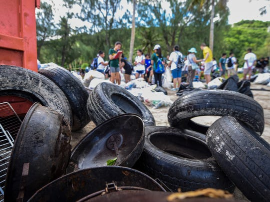 Old tires and metallic waste are set next to a waste container as other trash and debris are sorted during the 23rd Annual Guam International Coastal Cleanup 2017 at Tanguisson Beach on Saturday, Sept. 16, 2017.