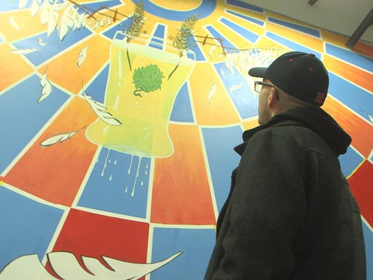 Features reporter Alex Biese looks at a mural in the
