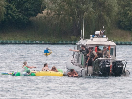 A Customs Border Protection boat helps floaters on