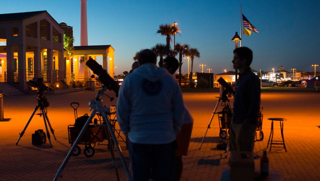 People participate in a stargazing event hosted by the Escambia Amateur Astronomer's Association on March 31, 2017, at Pensacola Beach.