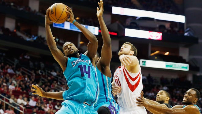 HOUSTON, TX - DECEMBER 31:  James Harden #13 of the Houston Rockets reaches for a rebound during their game against the Charlotte Hornets at the Toyota Center on December 31, 2014 in Houston, Texas.  NOTE TO USER: User expressly acknowledges and agrees that, by downloading and/or using this photograph, user is consenting to the terms and conditions of the Getty Images License Agreement. (Photo by Scott Halleran/Getty Images) *** Local Caption *** James Harden