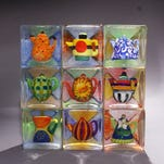 """""""Nine Teapots Series: 1920s Paris,"""" sand-cast glass by Stephanie Trenchard, one of two of her glass sculptures available in the Smithsonian Women's Committee 2015 Arts Invitational online auction."""