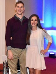 Chris Norton, left, poses for a photo with his fiancée, Emily Summers, after his 2017 speech at a fundraiser for his foundation, SCI CAN, at Prairie Meadows in Altoona.