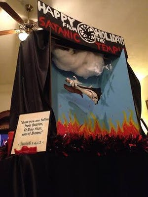 """The approved display will banner the phrase """"Happy holidays from the Satanic Temple"""" atop a diorama of an angel falling into hell."""