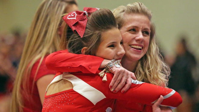 North Rockland's Melissa Grall gives her coach, Lauren Gould, a hug after cheering during the second day of competition.