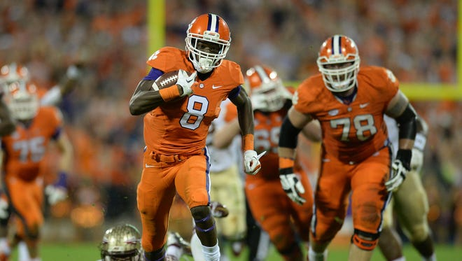 Clemson wide receiver Deon Cain (8) scores on a 38 yard catch and run against Florida State during the 3rd quarter Saturday, November 7, 2015 at Clemson's Memorial Stadium.
