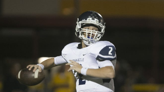 Pinnacle's Spencer Rattler (2) passes against the Mountain Pointe defense at Mountain Pointe High School in Phoenix, AZ on September 25, 2015.
