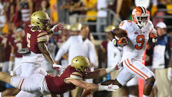 Clemson running back Wayne Gallman (9) scores against Boston College on a 59 yard run during the 1st quarter at Boston College. He is expected back from a concussion sustained versus N.C. State on Oct. 15.