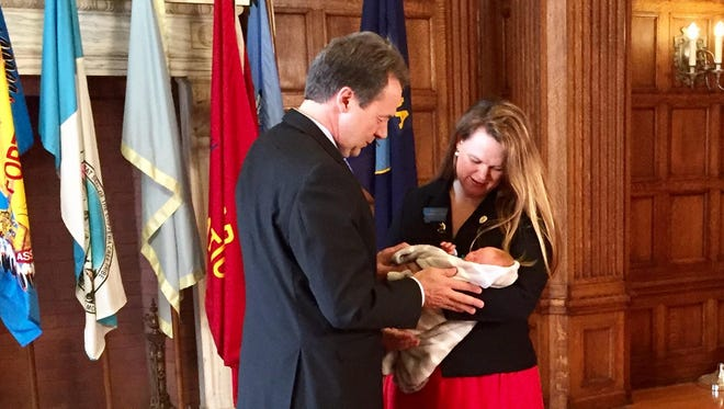 Gov. Steve Bullock speaks with Rep. Kimberly Dudik, D-Missoula and her son, Marcutio, who was born March 16.