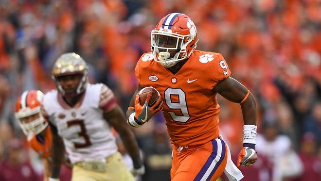 Clemson running back Travis Etienne (9) races 28 yards to score against Florida State during the 2nd quarter on Saturday, November 11, 2017 at Clemson's Memorial Stadium.