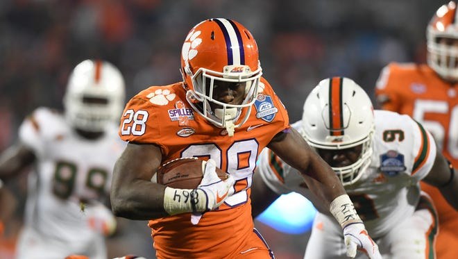 Clemson running back Tavien Feaster (28) breaks free to score against Miami during the 3rd quarter of the ACC championship game against Miami at Bank of America Stadium in Charlotte on Saturday, December 2, 2017.