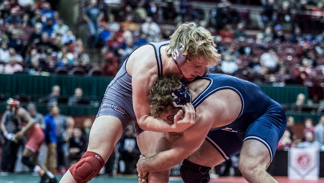 Sheridan's Owen Loughman, 195 pounds, wrestles Germantown Valley View's Stone Day in the quarterfinals. Loughman lost that match 11-4.