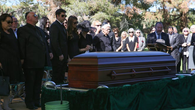 Friends and family say their final goodbyes during the funeral for Mel Haber at Desert Memorial Park, November 3, 2016.