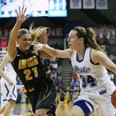 Drake's Cortni Rush tries to dribble the ball past Iowa's Melissa Dixon on Sunday. All 10 of Dixon's made field goals were from 3-point range. Dixon finished with 31 points.