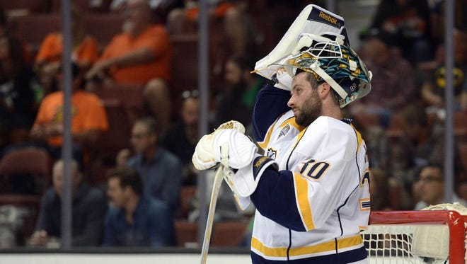 Predators goalie Carter Hutton looks on during the first period Sunday against Anaheim. The Ducks took a 3-0 lead in the period and won 4-2.