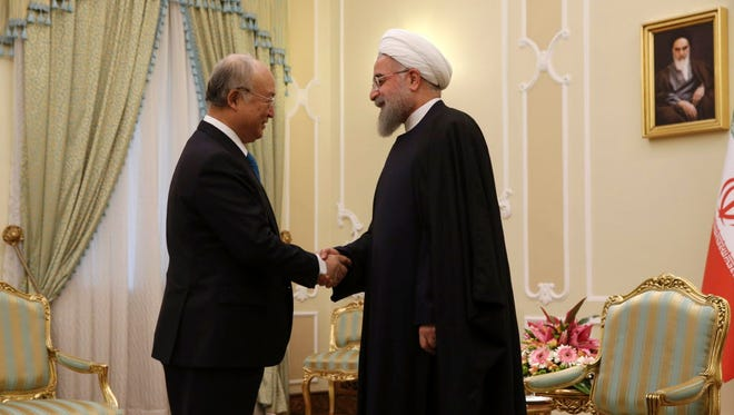 Iranian President Hassan Rouhani welcomes Yukiya Amano, head of the International Atomic Energy Agency, to Tehran on Jan. 18, 2016.