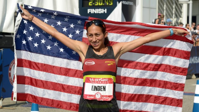 Desiree Linden poses with American flag after placing second during the 2016 U.S. Olympic Trials marathon in February.