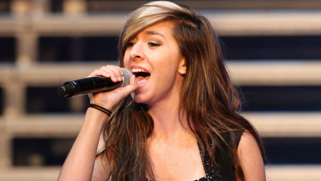 """In this June 29, 2014 file photo, """"The Voice"""" Season 6 contestant Christina Grimmie performs as part of """"The Voice Tour"""" at Cobb Energy Centre, in Atlanta."""