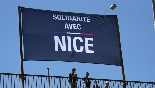 """A banner reading """"Solidarity with Nice"""" displayed at the Promenade des Anglais in the French Riviera in Nice."""