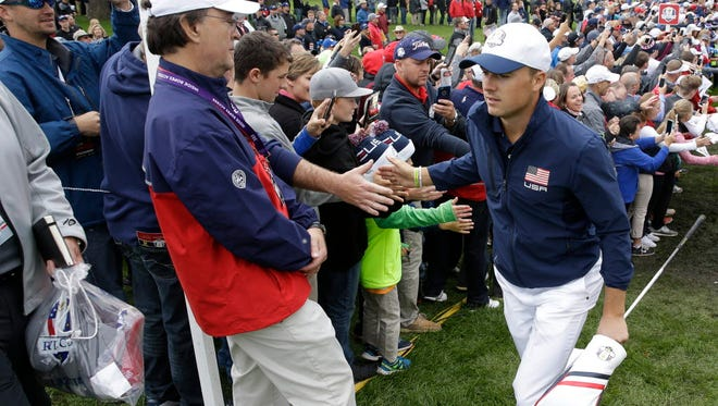 Jordan Spieth heads to the 16th tee during the practice round for the Ryder Cup.