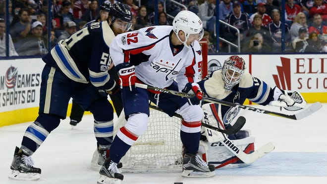 Washington Capitals center Evgeny Kuznetsov (92) looks to pass against the Columbus Blue Jackets during the third period at Nationwide Arena.
