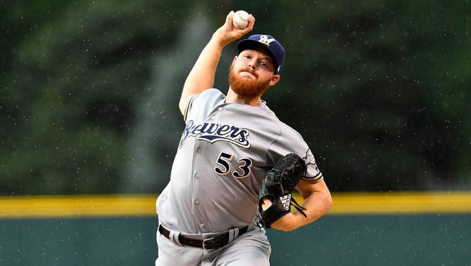 Brandon Woodruff was optioned to Class AAA Colorado Springs to make room for Chase Anderson on Sunday.