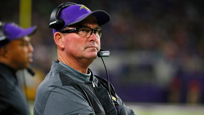 In this Aug. 31, 2017, file photo, Minnesota Vikings head coach Mike Zimmer watches from the sidelines during the second half of an NFL preseason football game against the Miami Dolphins, in Minneapolis.