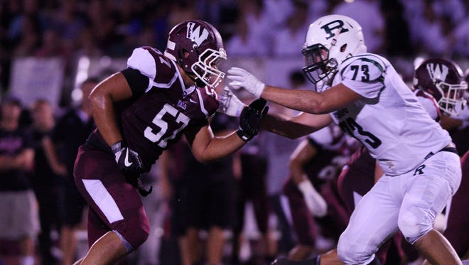 Wayne Hills DE Jason Modak had 12 tackles, including two sacks, in the Patriots' win over Passaic Valley.