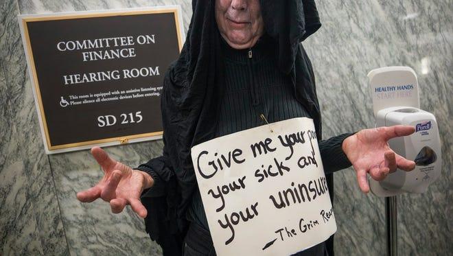 Health bill protester outside a Senate hearing room, Washington, Sept. 25, 2017.