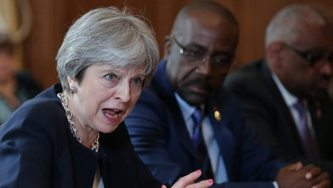 Britain's Prime Minister Theresa May hosts a meeting with leaders and representatives of Caribbean countries in London on April 17.