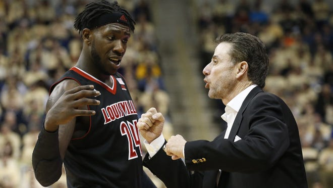 Forward Montrezl Harrell talks with coach Rick Pitino during Sunday's game.