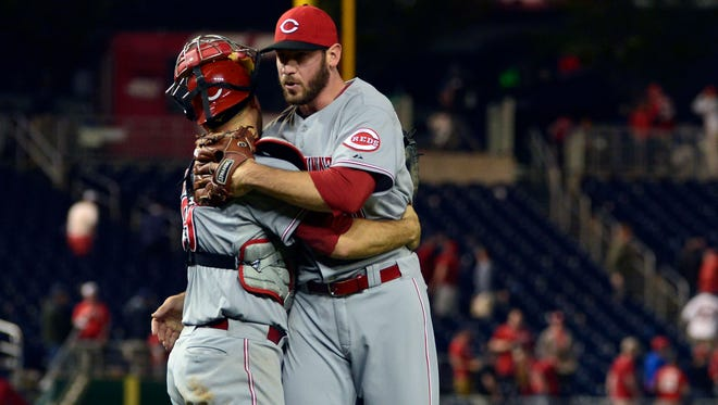 Cincinnati Reds catcher Devin Mesoraco (39) celebrates with relief pitcher Logan Ondrusek (66) after defeating the Washington Nationals in 15 innings at Nationals Park.