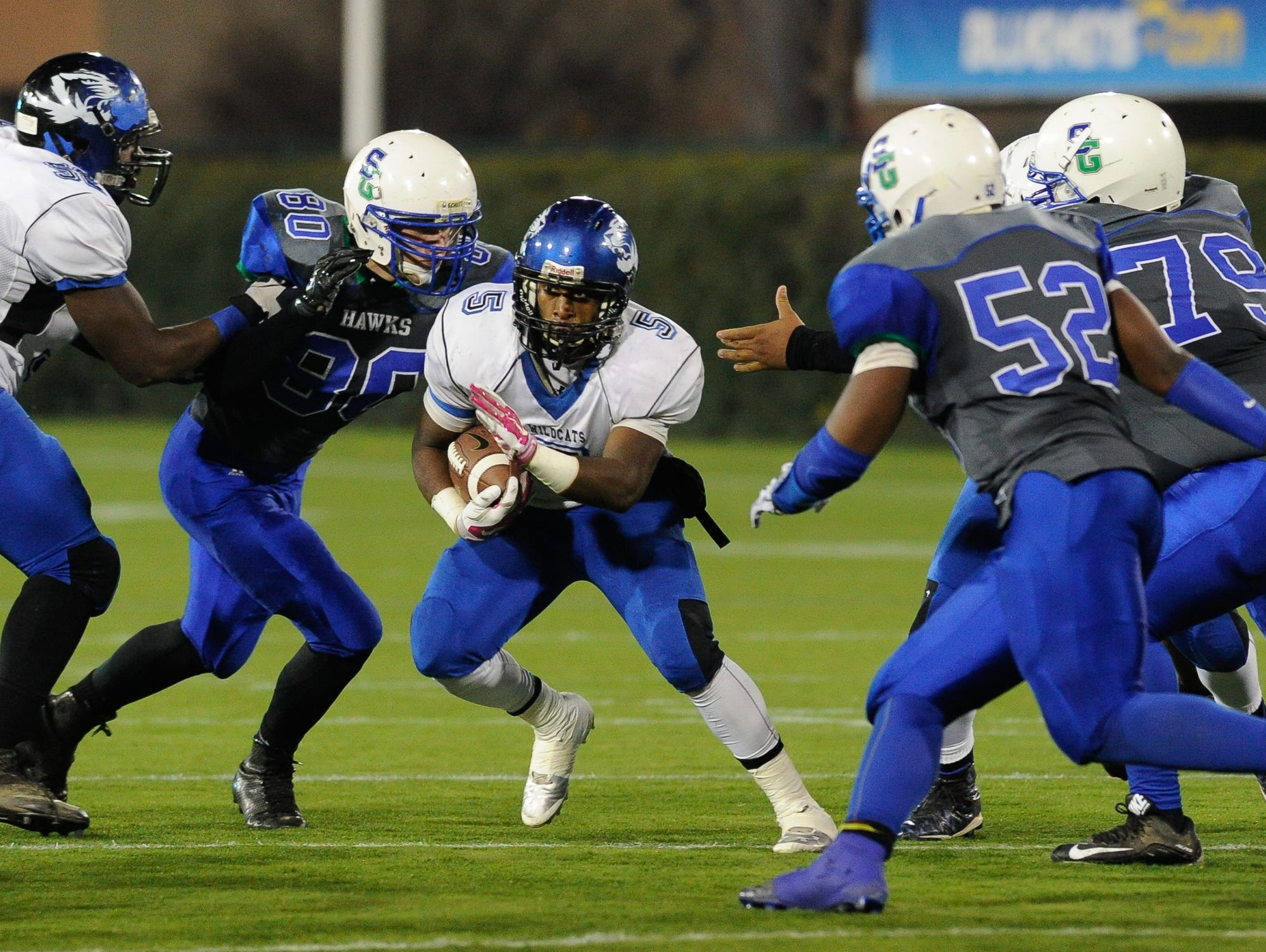 Howard's #5 Gerald Wiggins runs the ball during the Division II championship against St. Georges.