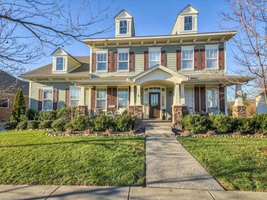 This four-bedroom Franklin home has an optional fifth bedroom. Features include a downstairs master suite, granite countertops and numerous custom additions.