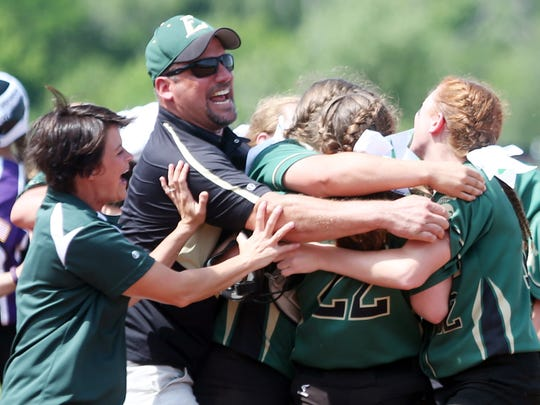Laconia head coach Scott Ritzema has a group hug after Laconia defeated Grantsburg for the WIAA D-3 State Softball Championship at the Goodman Diamond in Madison.