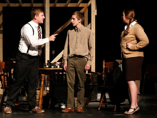 "St. Mary's Springs students Andrew Hoepfner, Drew Huck and Theresa Peters act out a scene for the upcoming play ""The Diary of Anne Frank"" at the North Fond du Lac PAC. The play will run Nov. 18, 19 and 20."