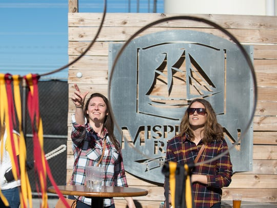 "Miranda Smith, left of Magnolia, Del., and Alexa Seidenfeld of Hoboken, N.J., play quidditch pong at ""Fantastic Beers and Where to Find Them"" at Mispillion River Brewing in Milford where they unveiled five Harry Potter themed beers Saturday."