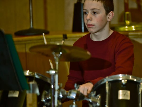 Aaron Gesell plays the drums during Shippensburg 6th