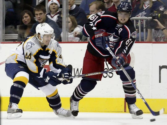 Predators defenseman Kimmo Timonen defends Blue Jackets forward Rick Nash during a 2005 game.