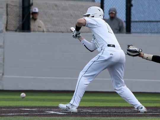 Iowa Park's Justin Thornhill bunts in the game against