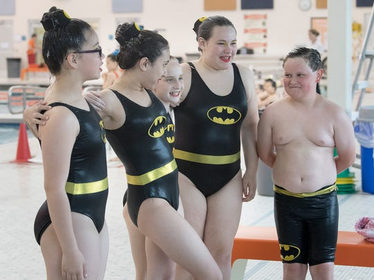 From left, Verona Zhang, Keira Alhadeff, Lillian Doyle, Kayleigh Veach and Greyson Howard pose for a picture for families before competing in the team free final for ages 12 and under during the 2018 USA Synchronized Swimming East Zone Championships at Central York High School in Springettsbury Township Sunday.