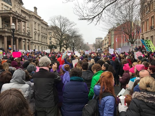 A crowd of people move down a street in Trenton on Saturday for the Women's March on New Jersey, which was in solidarity with the march on Washington D.C.