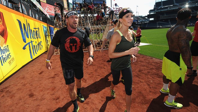 Celebrity trainers Chris Powell, left, and Heidi Powell participated in the Reebok Spartan Race in New York in 2014.at Citi Field on April 12, 2014 in New York City.