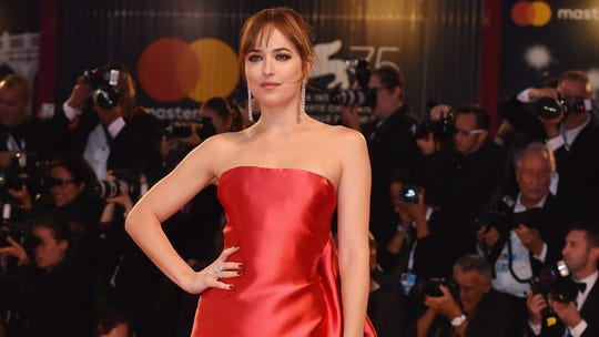 Dakota Johnson mourns her tooth gap: 'I'd really appreciate some privacy at this time'