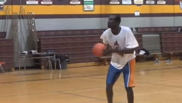 In a stunning development, a star center for a Canadian high school basketball team was exposed as a 30-year-old African refugee, leading to his being detained in connection with the Immigration Refugee Protection Act.