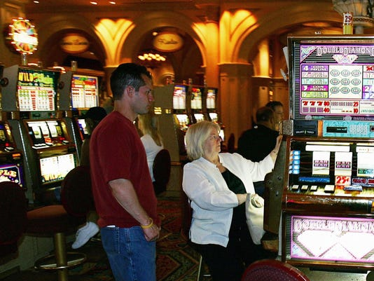 Gamblers play the slot machines inside t
